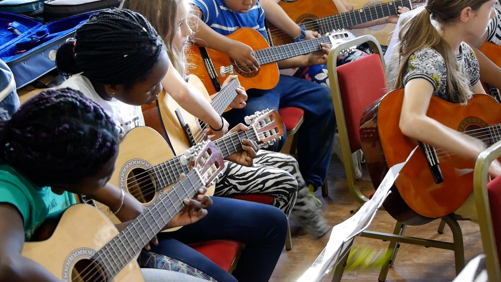 Children playing guitars at Music Camp