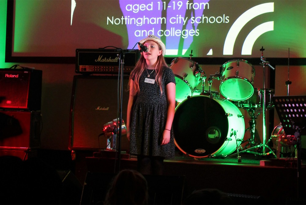 Ellie singing at the Sing City competition in 2016