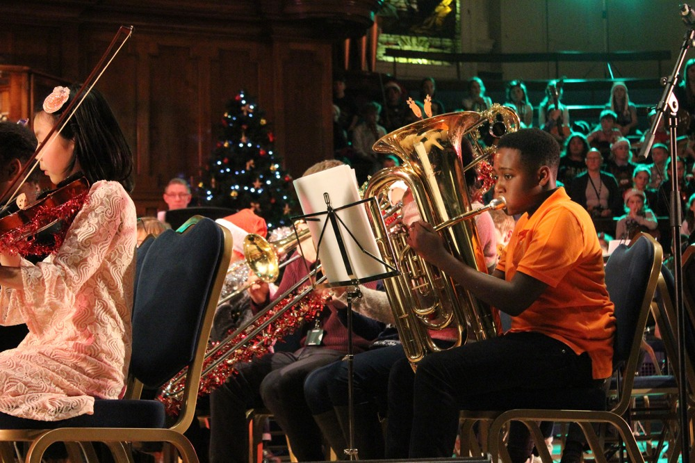 Young people performing at the Christmas in the City concert at Albert Hall