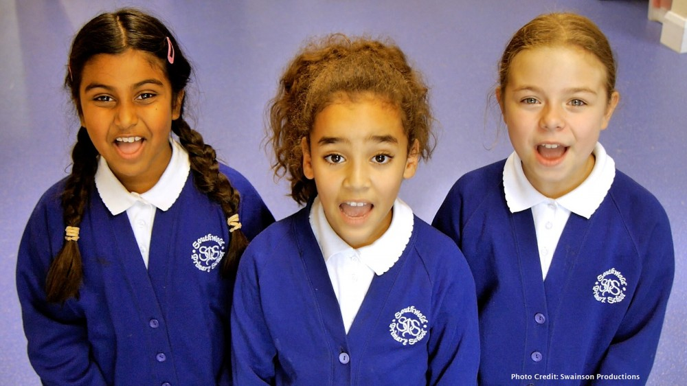 Primary school pupils performing as part of the recording for our charity single If Every Child Could