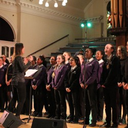 Secondary school students singing at the Christmas concert at Albert Hall